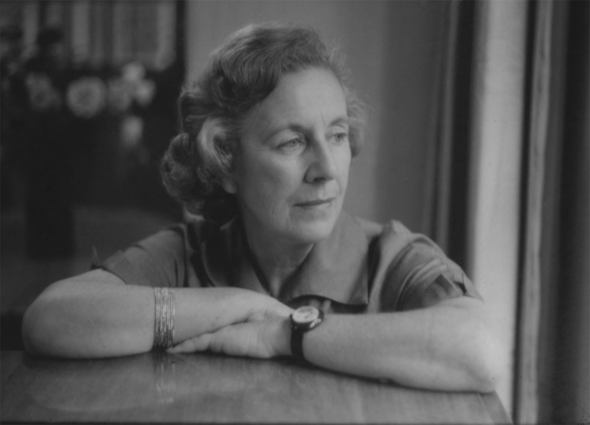 Black and white portrait of woman with arms crossed