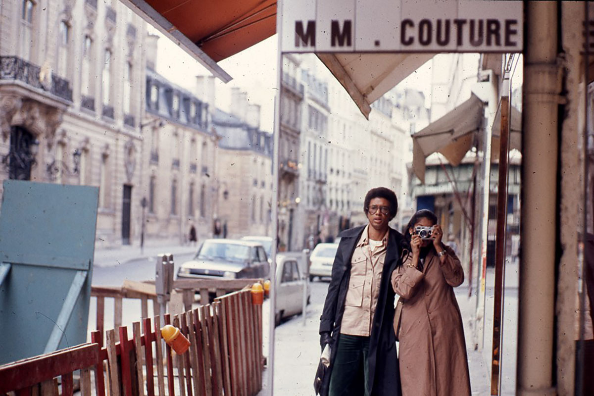 Paris street with photographer and Arthur Ashe in reflection